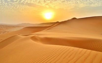 sunset-edge-rolling-sand-dunes-260nw-1168309345.jpg